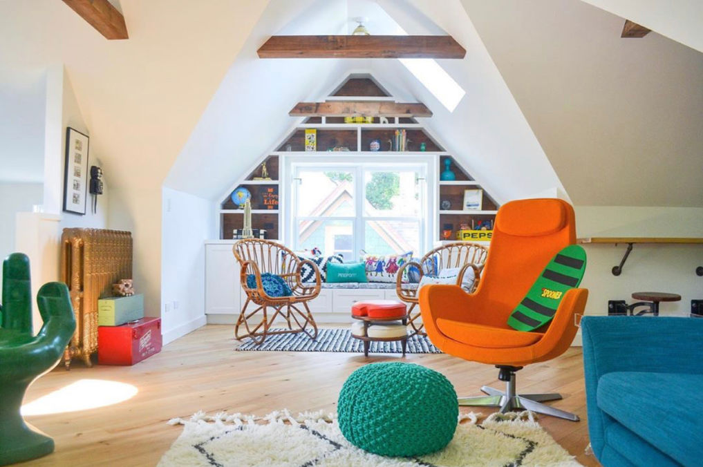 Attic playroom with colorful vintage furniture and wood ceiling beams #bohodecor #kidsrooms #playrooms #atticdecor #midcenturydecor #vintagedecor #colorfuldecor