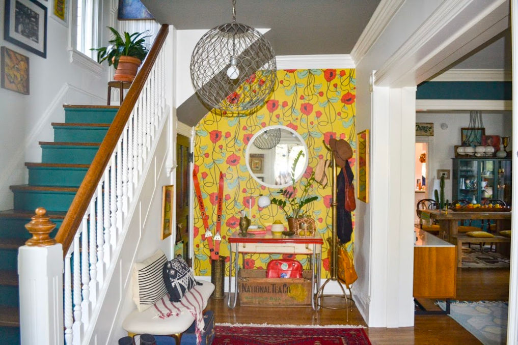 Colorful entry with red poppy wallpaper and blue painted stair risers #foyer #foyerdecor #entry #entrydecor #colorfuldecor #colorlovers #wallpaper #floralwallpaper #poppies #vintagedecor #eclecticdecor #hometour