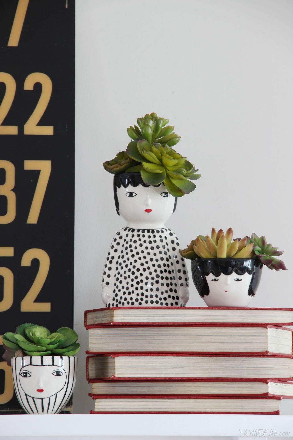 Love this trio of face planters filled with succulents for hair kellyelko.com #succulents #plantlady #houseplants #faceplanters #headplanter #planters #uniqueplanter #blackandwhite #kellyelko