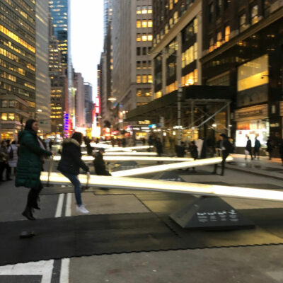 Giant glow in the dark teeter totters in New York kellyelko.com #nyc #newyork #manhattan #travel #travelblogger #travelblog #vacation #kellyelko