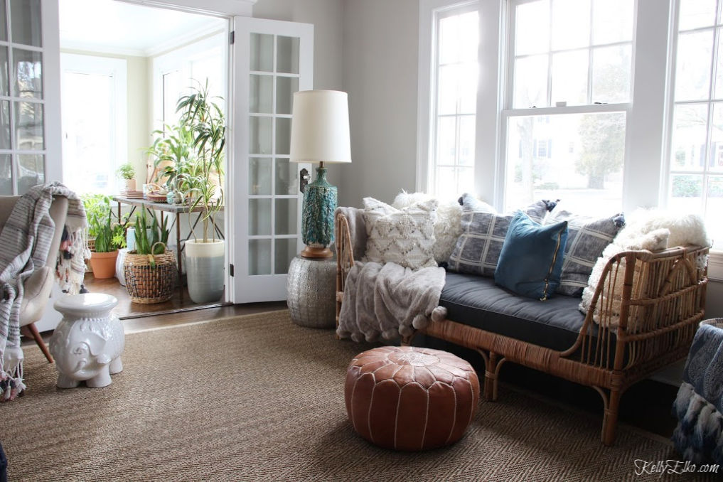 Love this eclectic home with touches of vintage and boho kellyelko.com #vintagedecor #eclecticdecor #bohodecor #houseplants #rattanfurniture #ourarticle #vintagelamp #midcentury #livingroomdecor #kellyelko