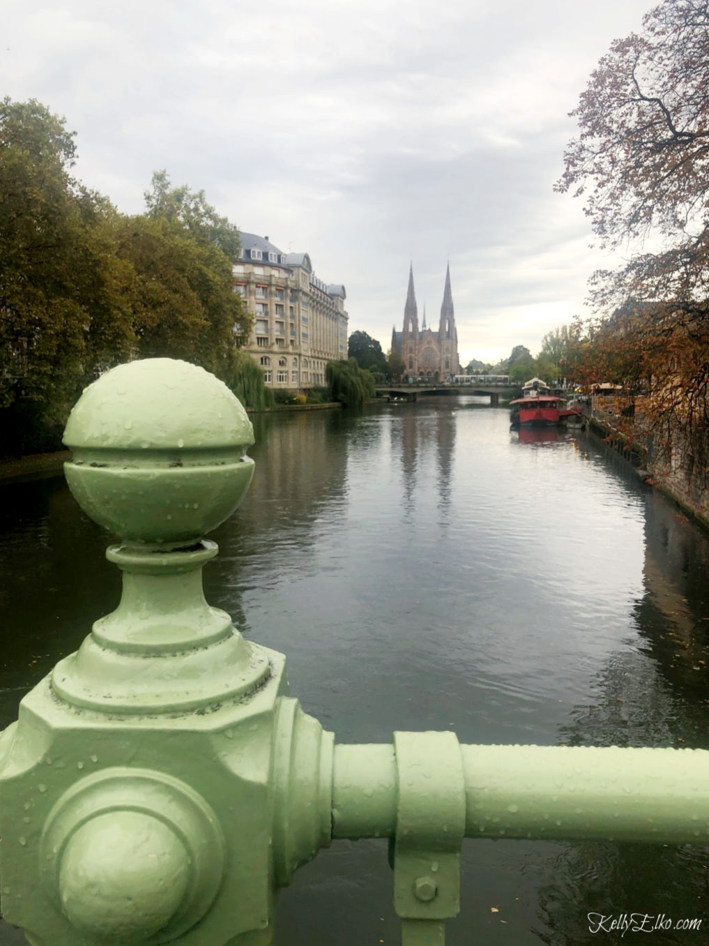 Strasbourg Cathedral from a bridge across the canal kellyelko.com #strasbourg #strasbourgcathedral #cathederal #rivercruise #luxurytravel #france #exploreeurope #travelblog #travelblogger