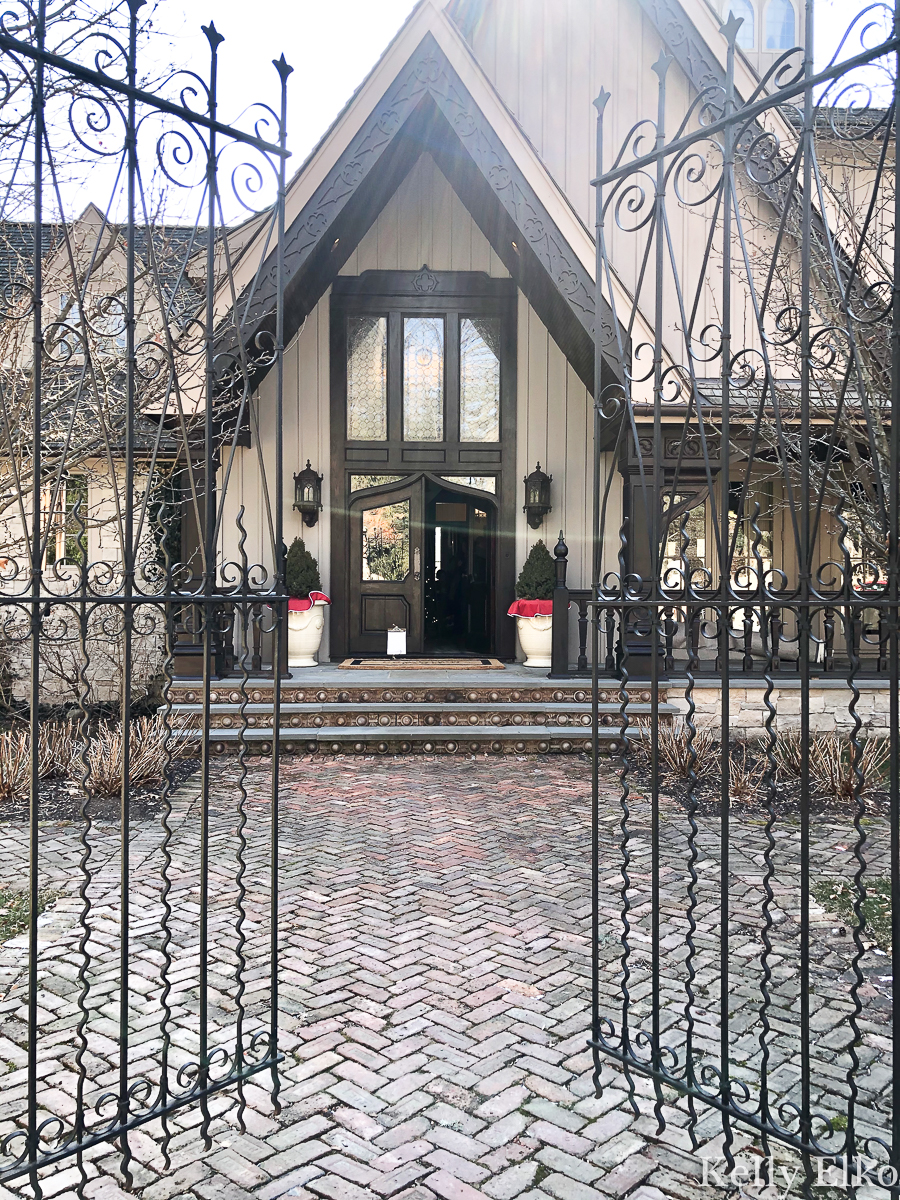 Beautiful iron gates lead and brick herringbone path lead to this stunning home kellyelko.com #gates #irongates #ironwork #oldhome #brickpath #brickwalkway #frontporch