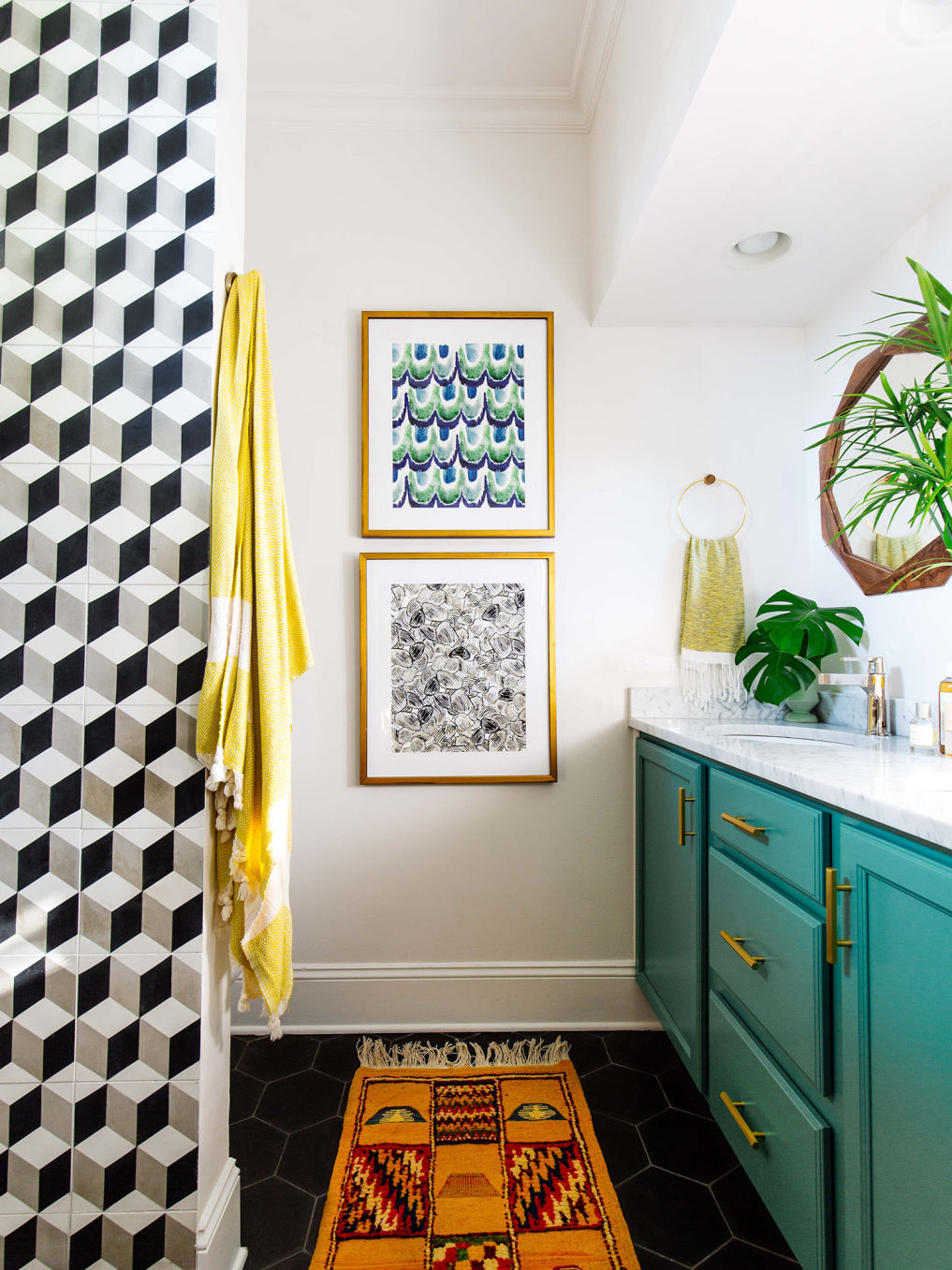 Graphic black and white tile in this small bathroom with turquoise vanity #bathroom #tile #blackandwhite #bathroomvanity #bathroomdecor