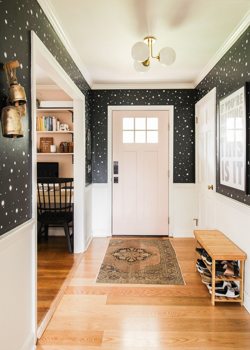 Love this foyer with graphic black and white wallpaper and blush pink front door