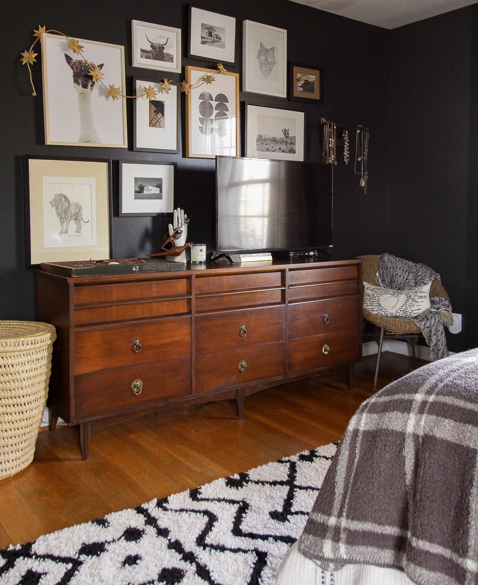 Love this TV gallery wall and black paint