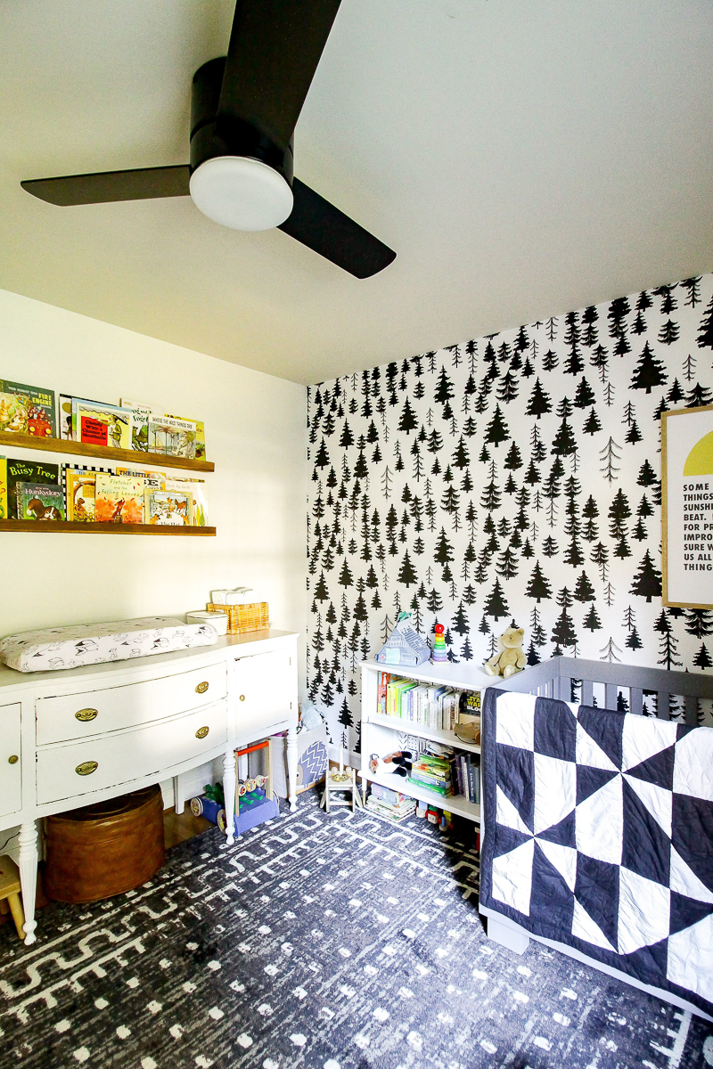 Love this adorable nursery with black and white tree wallpaper