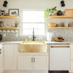 Eclectic Home Tour Cassie Bustamante kellyelko.com #kitchen #kitchendecor #kitchenshelves #openshelves #terrazzo #hometour #housetour #farmhousesink #bohodecor