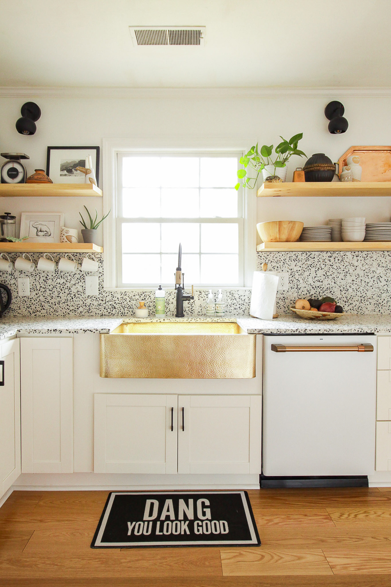 Eclectic Home Tour of Cassie Bustamante kellyelko.com love this brass farmhouse sink and open shelves