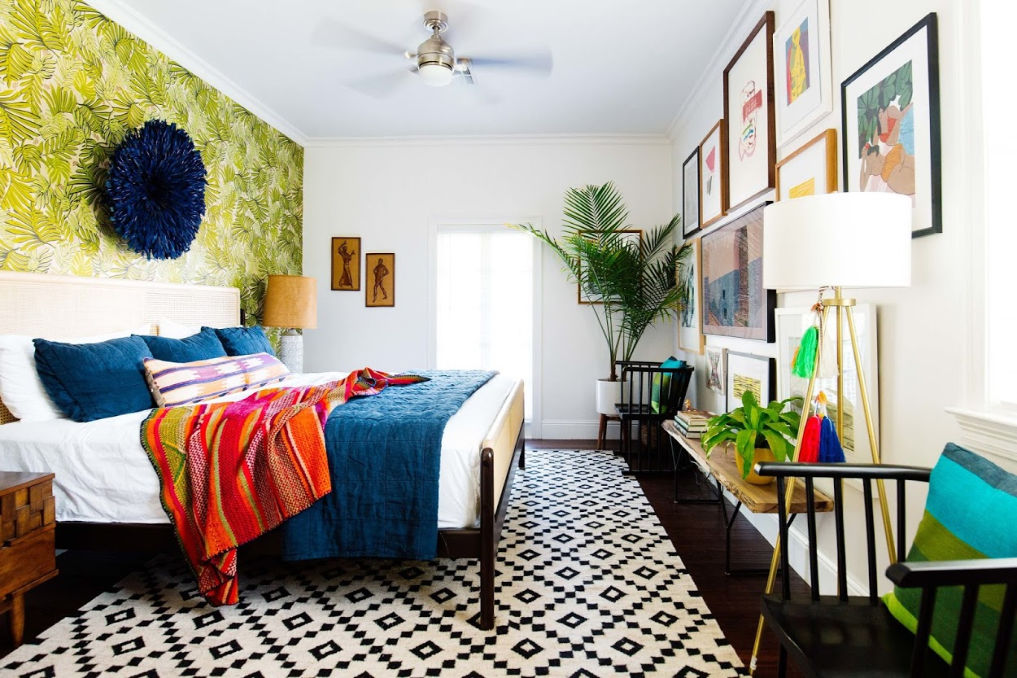 Colorful master bedroom with tropical wallpaper and gallery wall #masterbedroom #bedroomdecor #wallpaper #bedroomwallpaper #colorful #bohodecor #eclecticdecor #bedroomfurniture #gallerywall