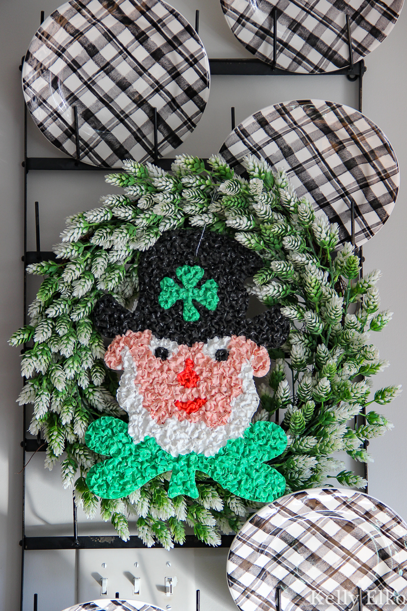 Cute vintage leprechaun on a wreath kellyelko.com #leprechaun #stpatricksday #stpaddysday #vintagedecor #vintage #plaid #kitchendecor #diywreath #wreath #crafts