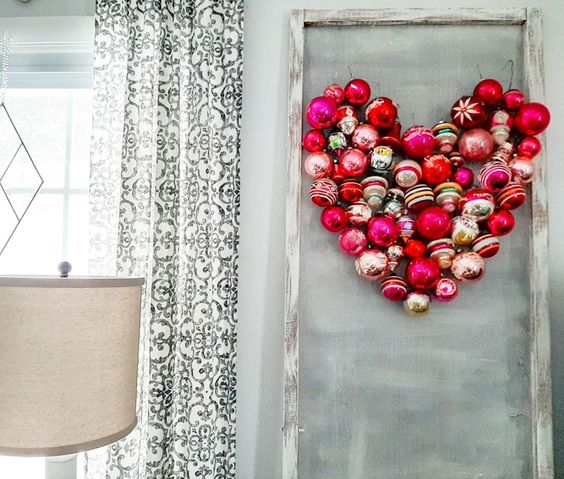 Turn your Christmas ornaments into this fun ornament heart for Valentine's Day kellyelko.com #shinybrite #vintageornaments #christmasornamentcrafts #ornamentcrafts #valentinesdecor #vaentinedecor #hearts #valentineparty #valentinesparty #diyideas #diycrafts #crafts