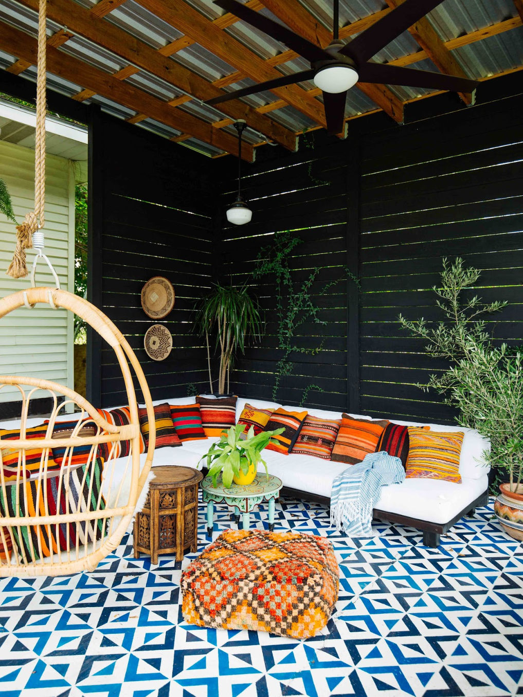 Love this colorful patio with stenciled concrete and colorful pillows #patio #patiodecor #patiofurniture #bohodecor #eclecticdecor