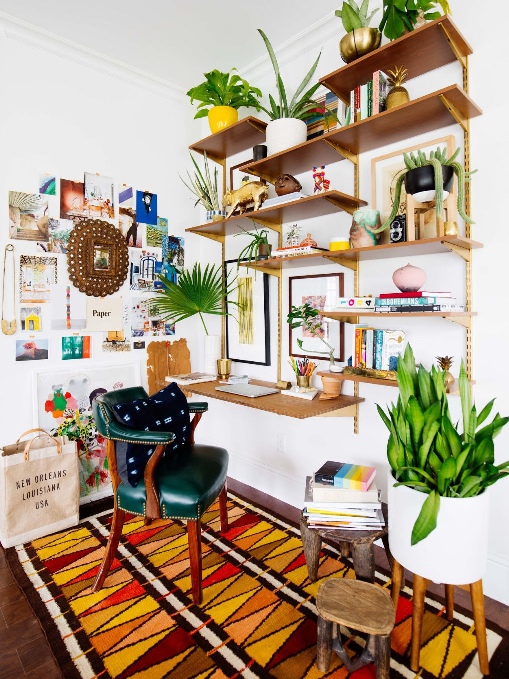 Turn an unused corner into a home office with open shelves and an inspiration board #homeoffice #office #smallspaces #colorful #bohodecor #openshelves #desk #vintagedecor #vintagemodern