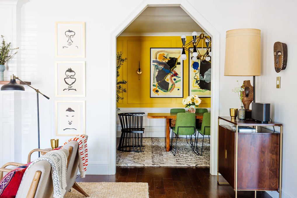 Tour this colorful, eclectic home with a vibrant yellow dining room #yellow #homedecor #eclecticdecor #diningroomdecor #colorful #bohodecor