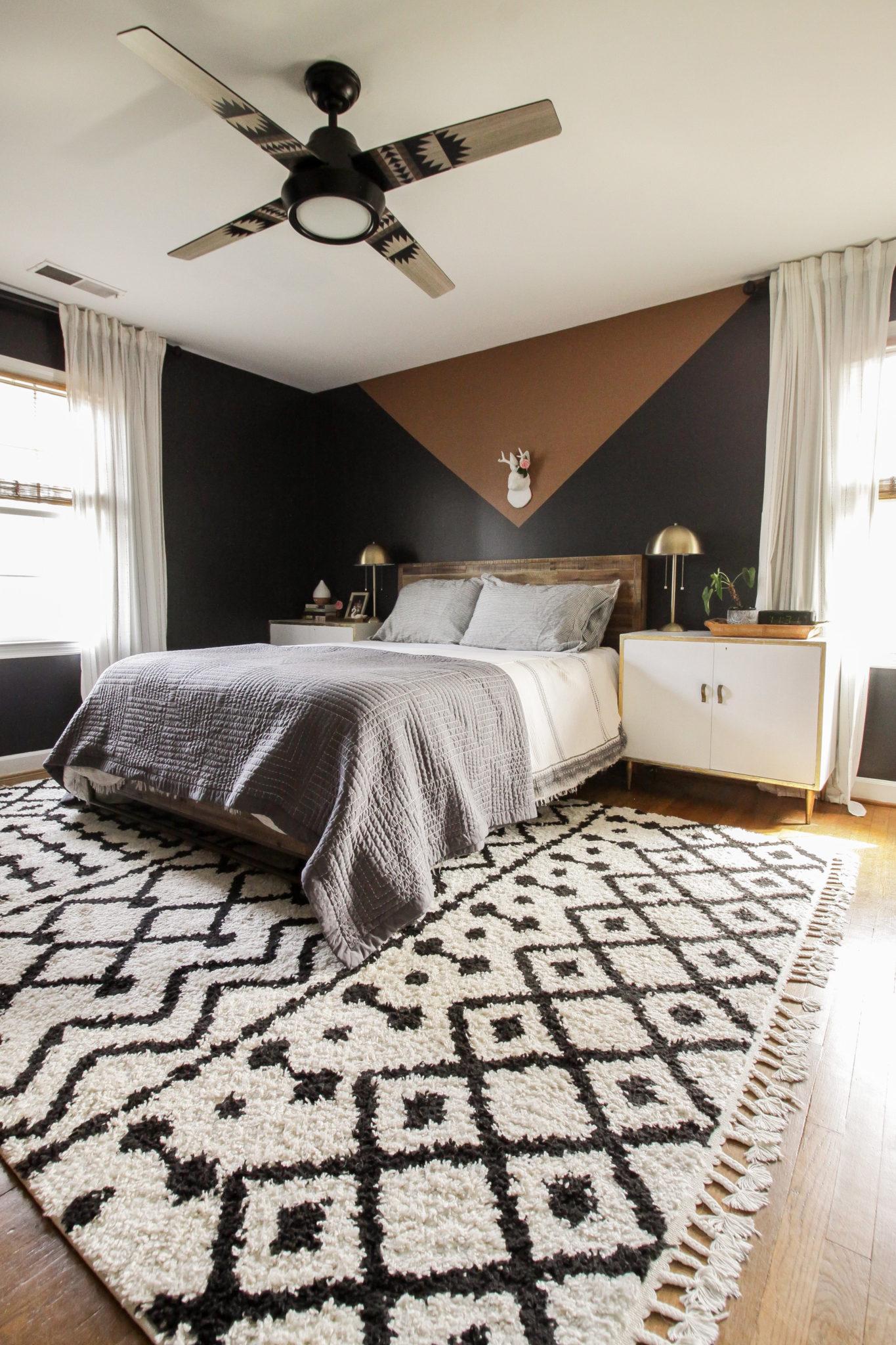 Cozy bedroom with black walls