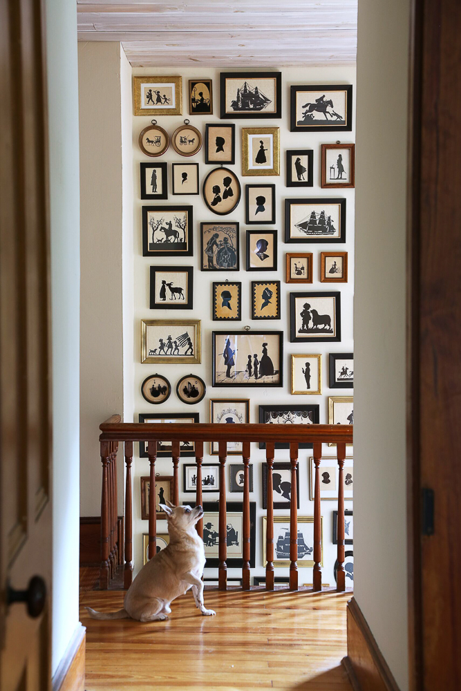 Love this antique silhouette art gallery wall that fills up the entire wall of this staircase kellyelko.com #antiques #art #silhouette #gallerywall #blackandwhiteart #staircase #farmhouse #collections #farmhousedecor #countryliving