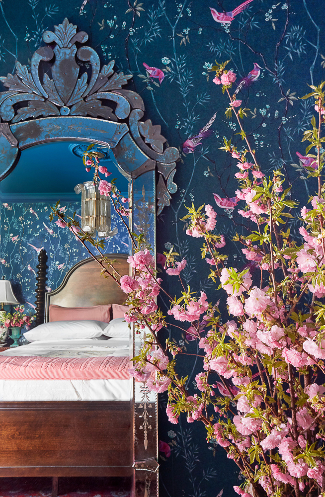 Whimsical blue and pink bird floral wallpaper kellyelko.com #wallpaper #birds #birdwallpaper #floralwallpaper #pinkwallpaper #navyblue #bluewallpaper #bluebedroom #venetianmirror #whimsicaldecor #vintagemodern #pinkflowers #farmhousedecor