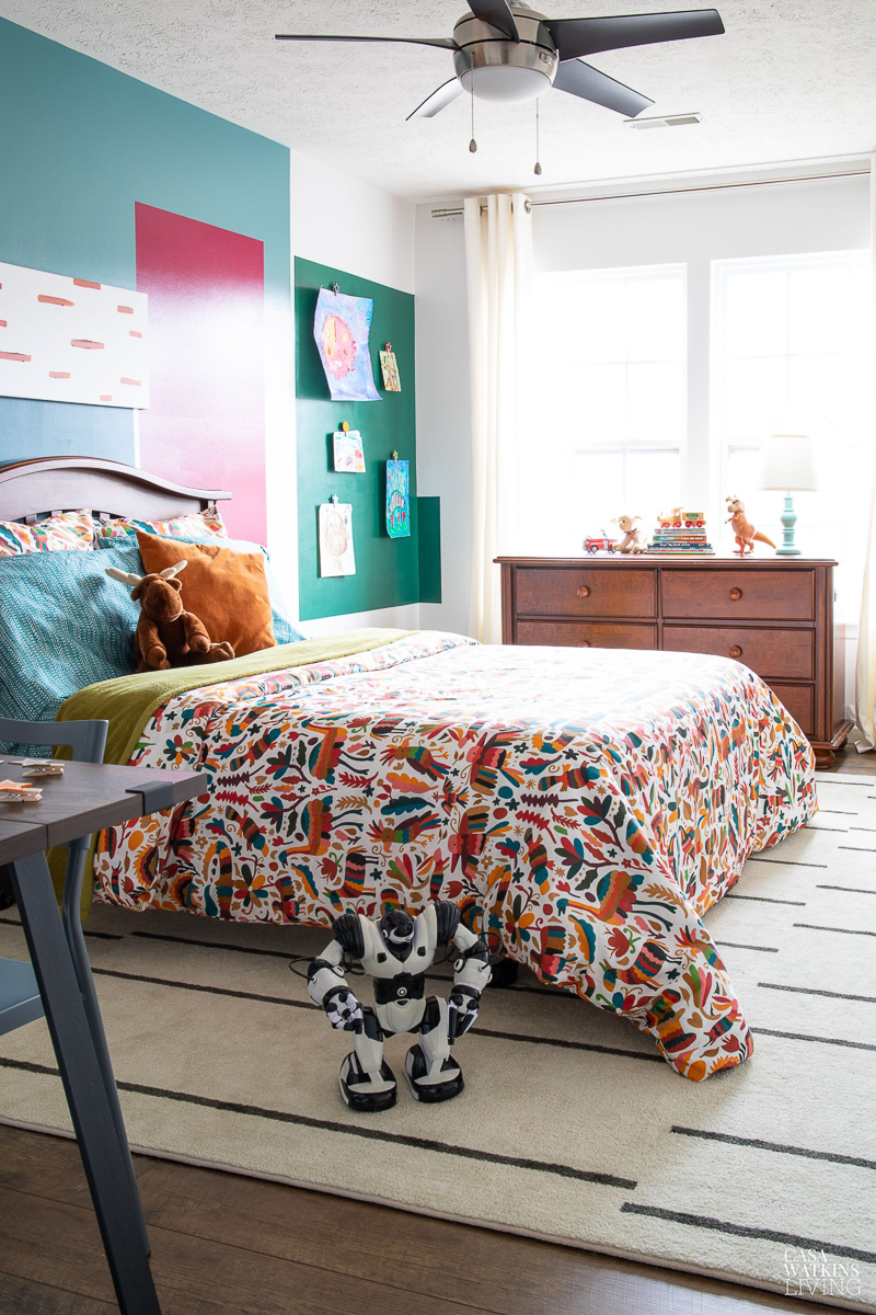 Colorful bedroom with otomi bedspread and color blocked walls #bedroom #kidsrooms #otomi #colorblock #diyideas #diydecor