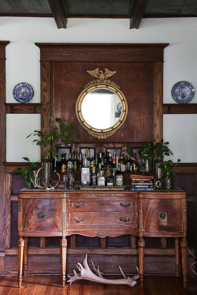 An antique buffet makes the perfect bar cart in this old farmhouse kellyelko.com #barcart #bar #cocktails #antiques #antiquefurniture #farmhouse #farmhousedecor #countryliving #traditionalhome