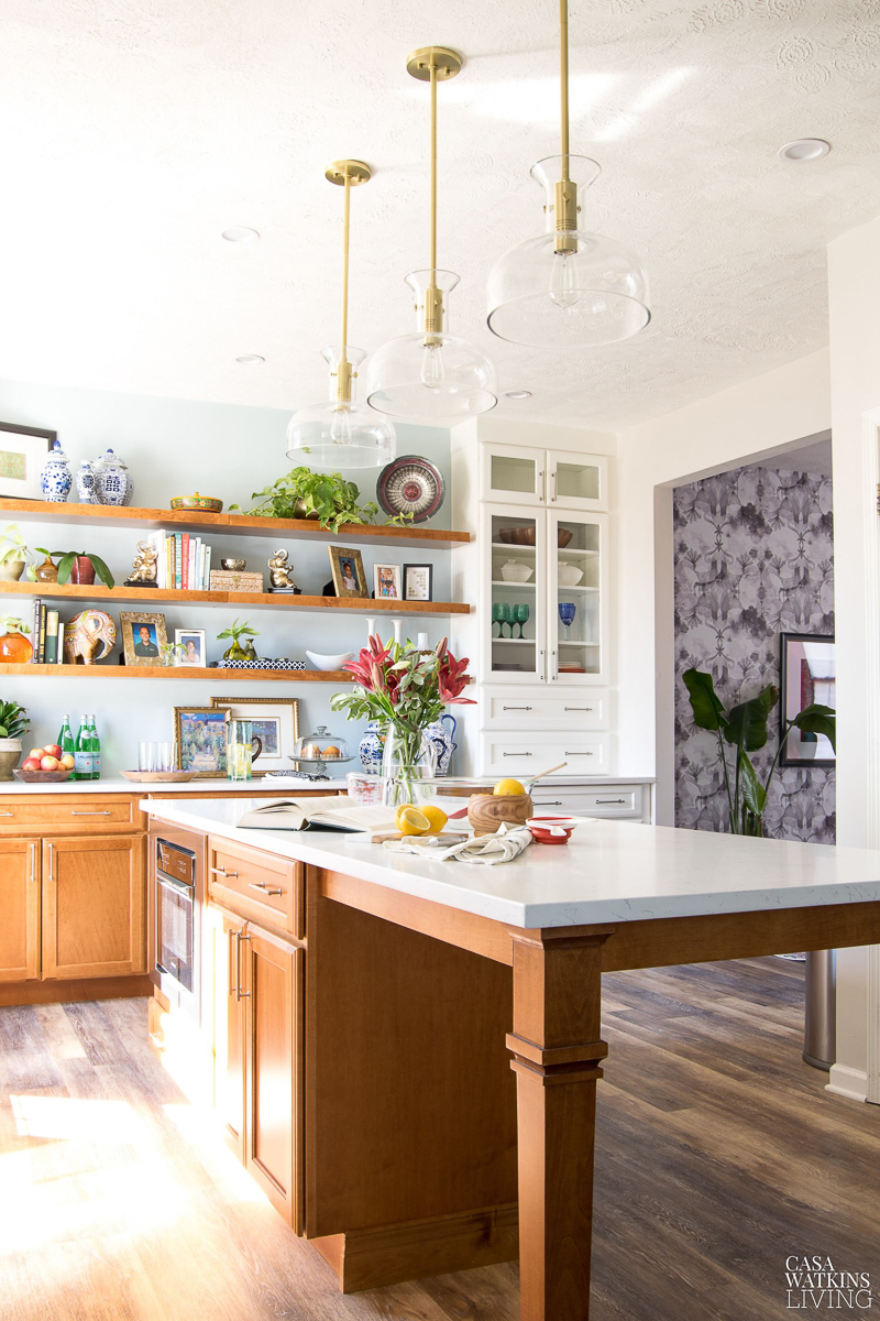Eclectic Home Tour - love this kitchen with open shelves filled with vintage finds and the brass lights and hardware #kitchen #kitchendecor #openshelves #bohodecor #kitchenisland #lighting #brass #thrifted