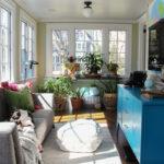 How to Hang Art on Windows and a Colorful Eclectic Plant Filled Sunroom kellyelko.com #art #sunroom #plantlady #houseplants #sunroomdecor #sunroomfurniture #vintagedecor #eclecticdecor #midcentury #paintedfurniture