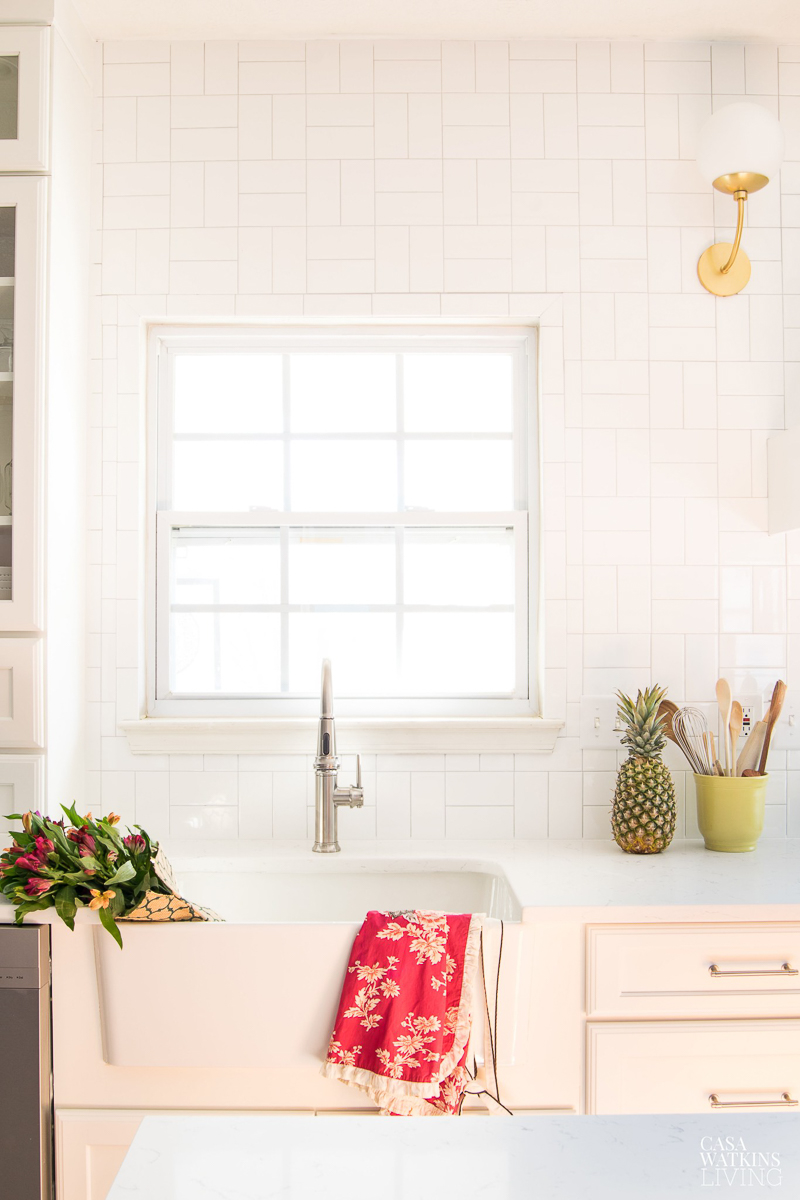 Hang subway tile in a square pattern for a unique look on a budget #kitchen #kitchentile #backsplash #subwaytile #kitchensink #farmhousesink #whitekitchen