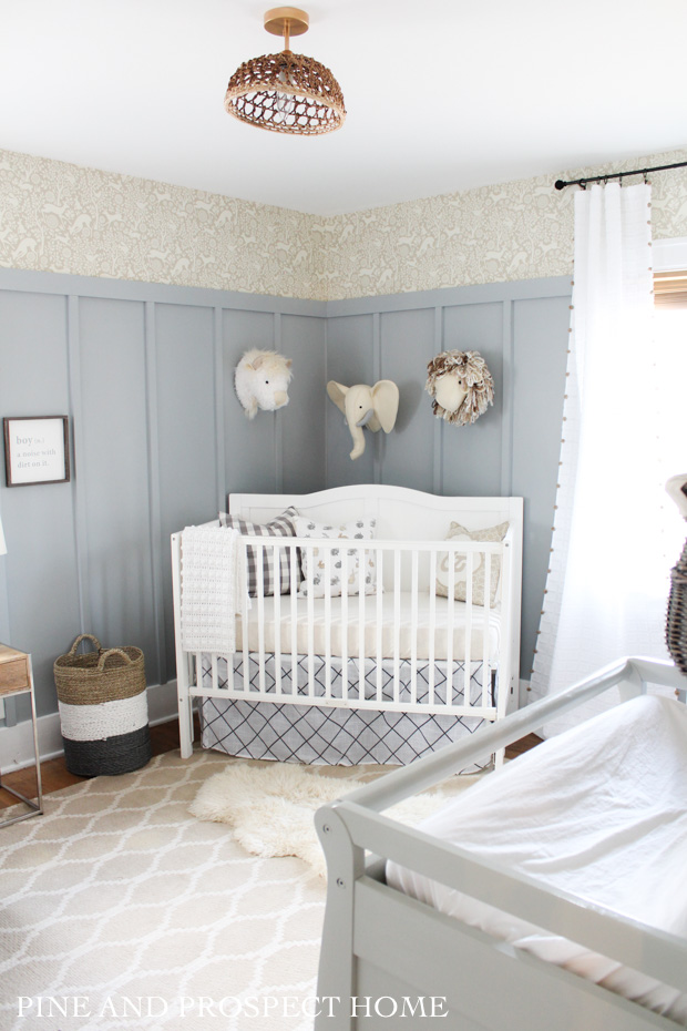 Adorable nursery with board and batten and stenciled walls #nursery #nurserydecor #kidsrooms #farmhousedecor