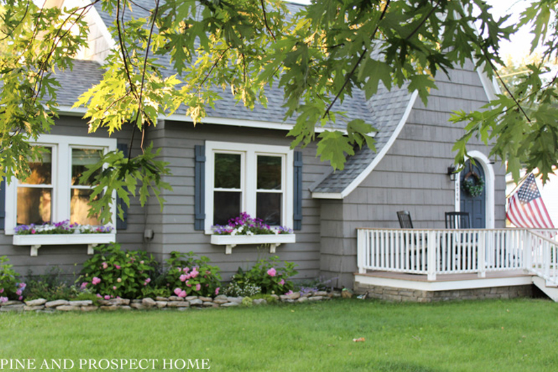 Tour this 1930's cottage filled with tons of DIY ideas #cottage #tudor #curbappeal #hydrangeas #housetour #hometour