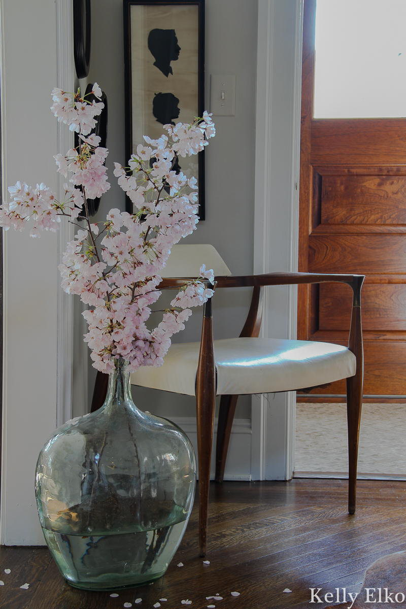 Love this eclectic foyer with a mix of old and new kellyelko.com #floweringbranches #silhouettes #midcenturydecor #eclecticdecor #vintagedecor #foyer