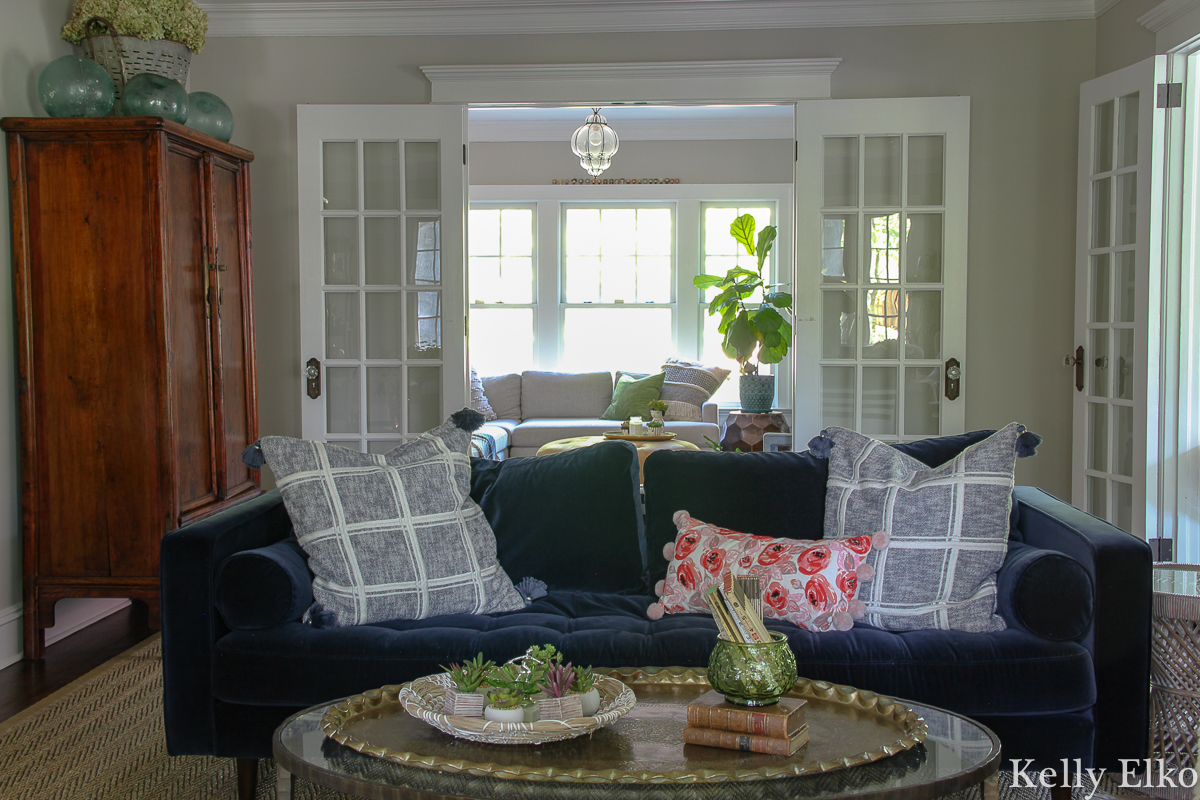 Love this eclectic living room with blue velvet sofa and lots of vintage finds kellyelko.com #vintage #vintagedecor #eclecticdecor #bohodecor #articlesofa #svensofa #modernvintage #interiorstyling #livingroom #livingroomdecor #kellyelko