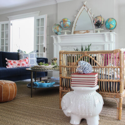 Living Room Furniture Arranging Tips kellyelko.com #livingroom #furniturearranging #eclecticdecor #vintagedecor #bohodecor #rattan #manteldecor #collections #collect #vintagemodern #globes #decorate