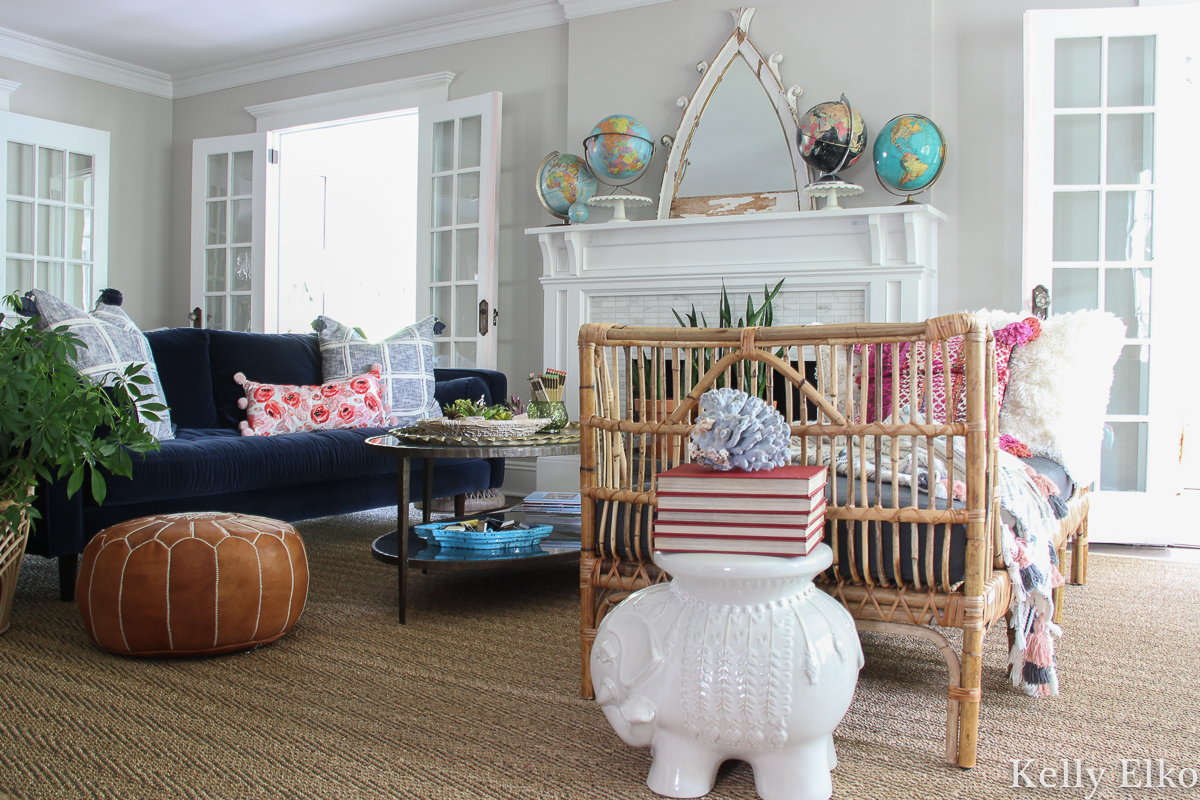 Love this eclectic boho living room with velvet sofa and rattan daybed and vintage globe collection kellyelko.com #livingroom #livingroomdecor #livingroomfurniture #manteldecor #eclecticdecor #bohodecor #rattan #rattanfurniture #daybed #furniturearranging #furniturearrangement #vintagedecor #modernvintage #interiordecor #ineriodesign #decorate #mantel #kellyelko #article #svensofa #collections #vintagecollection