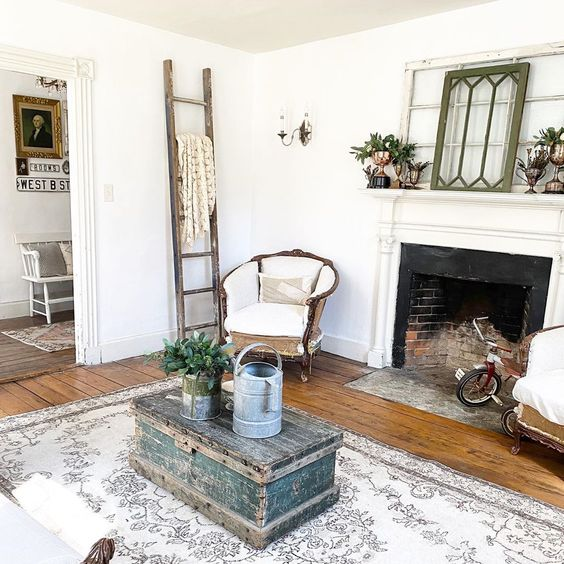 Love this charming farmhouse filled with vintage finds and the antique windows on the mantel #farmhouse #farmhousedecor #vintage #vintagedecor #antiques #mantel #manteldecor #neutraldecor #livingroomdecor #fixerupperstyle #homedecor #cottagestyle