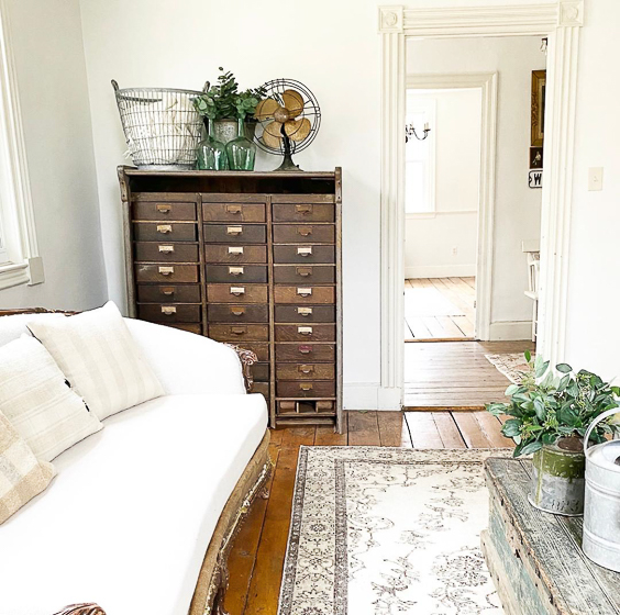Charming farmhouse tour filled with unique antiques and vintage finds like these cubbies #antiques #vintage #vintagedecor #cubbies #farmhouse #farmhousedecor #neutraldecor #fixerupperstyle