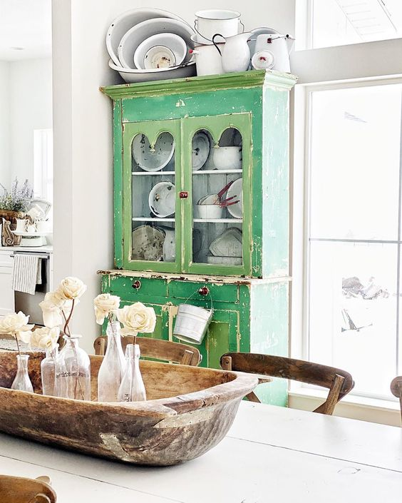 Love this green hutch in a neutral farmhouse dining room kellyelko.com #farmhouse #farmhousedecor #farmhousediningroom #hutch #milkpaint #green #greenfurniture #collections #enamel #enamelware #doughbowl #vintagedecor #vintagefurniture #paintedfurniture