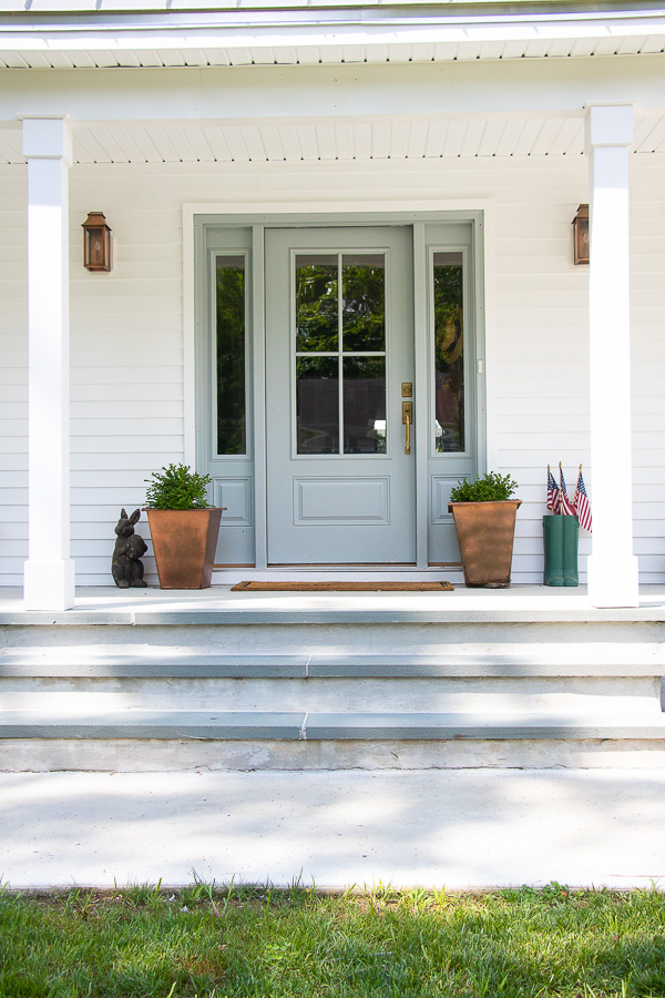Beautiful farmhouse porch with blue front door and copper accents #porch #farmhouse #farmhouseoporch #frontporch #farmhousedecor #hometour #housetour #curbappeal