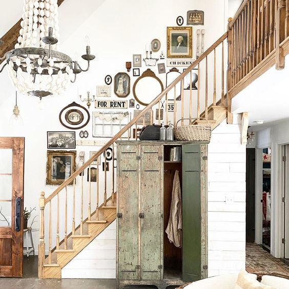 Eclectic Home Tour of The Little White Farmhouse - how amazing is that vintage gallery wall kellyelko.com #gallerywall #vintage #vintagedecor #farmhousedecor #foyerdecor #entrydecor #farmhousefoyer #farmhousestaircase #homedecor #shiplap
