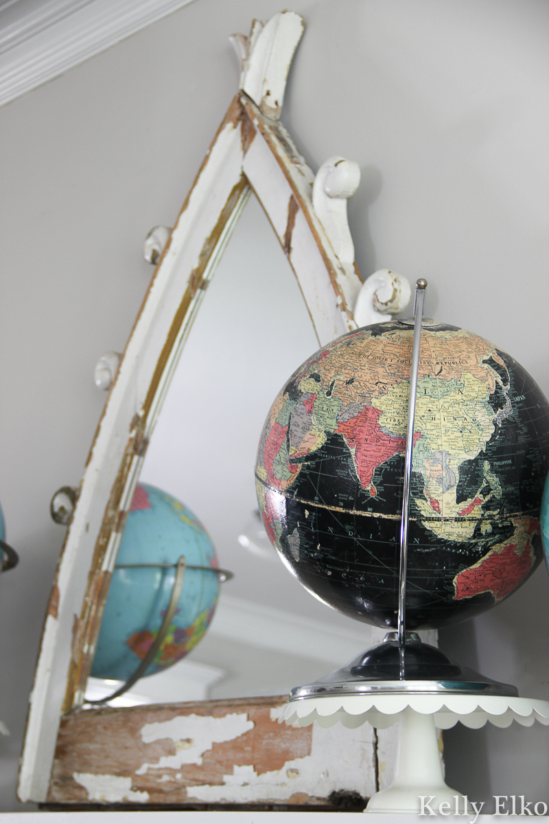 Vintage globe collection displayed on a mantel - love the unique black oceans globe kellyelko.com #globe #globes #vintageglobe #vintagedecor #vintagecollection #collection #collect #manteldecor #mantel #eclecticdecor #blackglobe #kellyelko