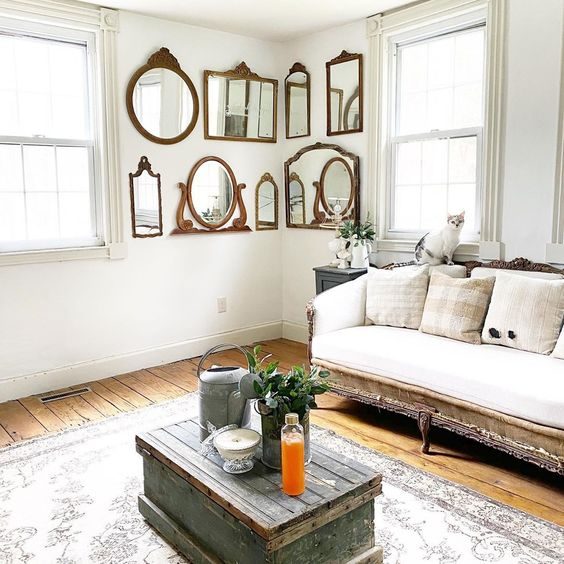 Love this collection of antique mirrors as a unique gallery wall in this charming farmhouse #gallerywall #antique #vintage #vintagedecor #mirrors #wallmirrors #farmhousedecor #vintagedecor #neutraldecor #farmhouse #housetour #hometour