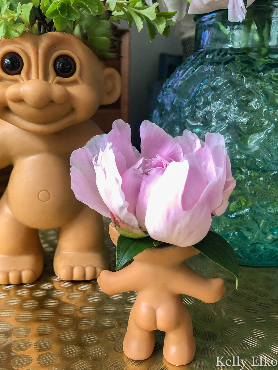 Turn a Troll doll into a kitschy planter or vase! kellyelko.com #troll #trolls #trolldolls #vintagedecor #upcycle #repurpose #kitsch #peonies #succulents #gardeners #houseplants #diyplanters #kidscrafts