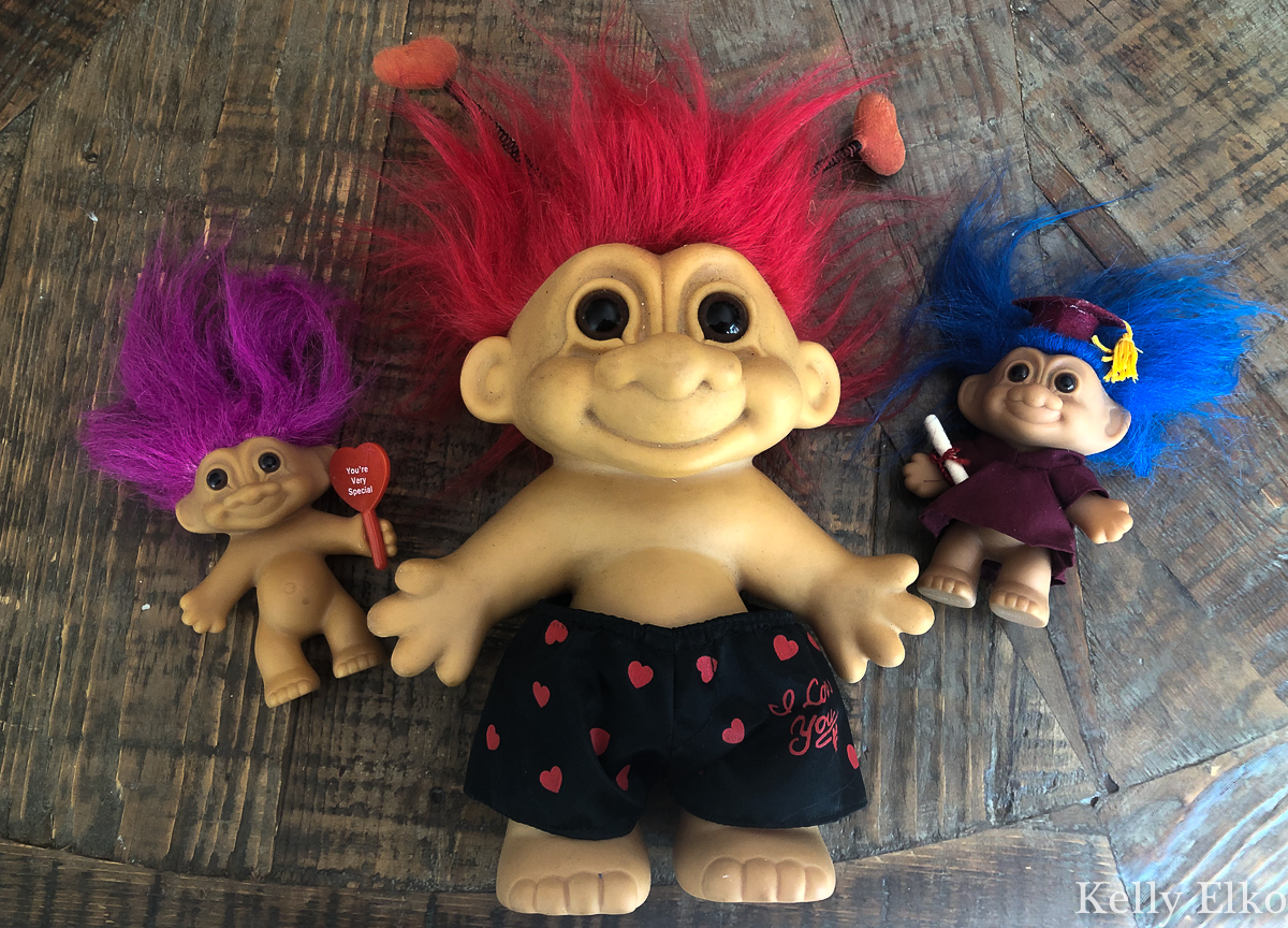 Vintage Troll dolls - you have got to see how she repurposed them! kellyelko.com #troll #trolls #trolldolls #upcycle #repurpose #planters #diyideas #kidscrafts
