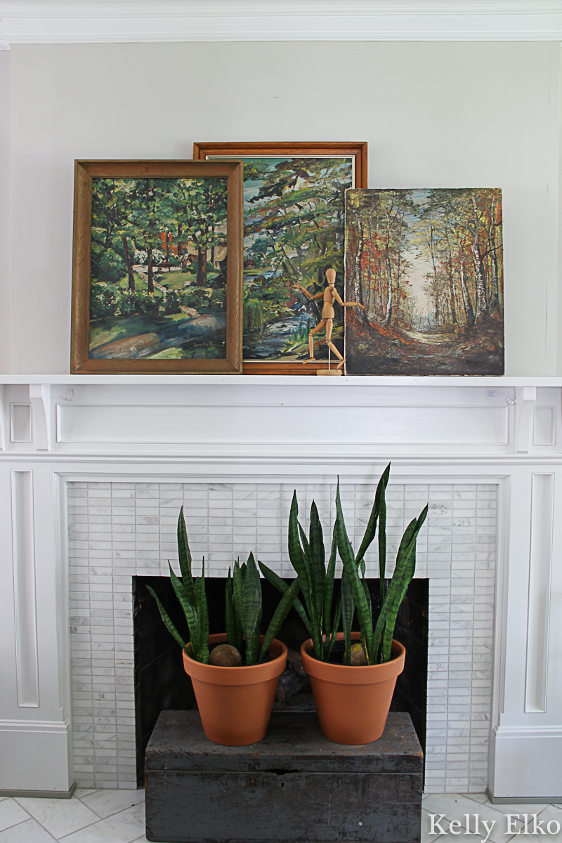 Fall mantel decorating ideas - I love the trio of vintage landscape paintings propped on the mantel kellyelko.com #fall #falldecor #fallmantel #vintagedecor #eclectic #art #vintageart #vintagepaintings #landscapepaintings #farmhousedecor #manteldecor