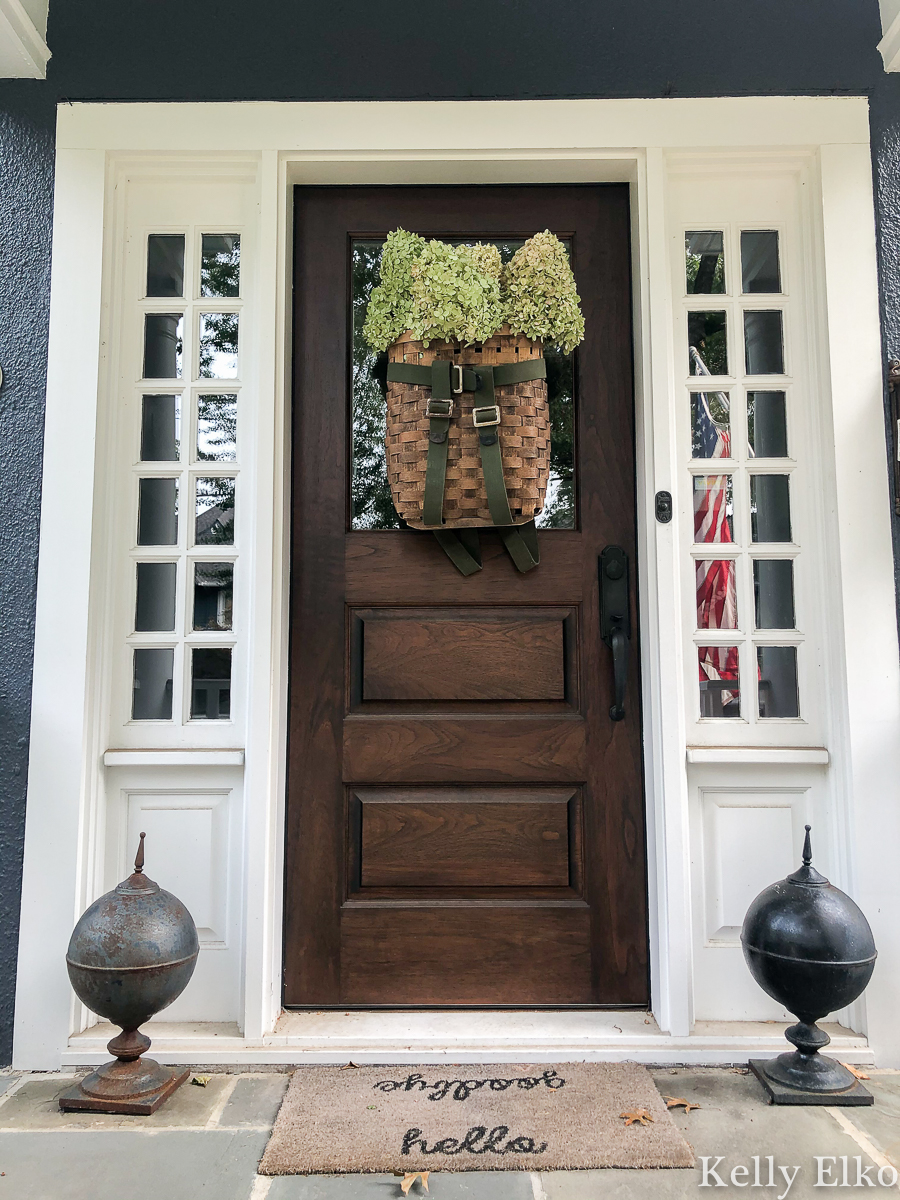 Love this basket wreath filled with hydrangeas kellyelko.com #basket #basketwreath #wreath #wreaths #fallwreath #summerwreath #curbappeal #diywreath #hydrangeas #limelight #vintagedecor #eclecticdecor #frontdoor #porch