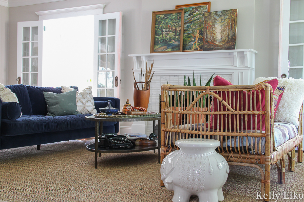Vintage lovers fall living room filled with so many creative decorating ideas kellyelko.com #fall #fallhome #falldecor #fallhometour #fallivingroom #eclecticdecor #vintagedecor #vintagefall #vintagepaintings #vintagelandscapes #bohodecor #rattan #article #rattanfurniture #eclectic