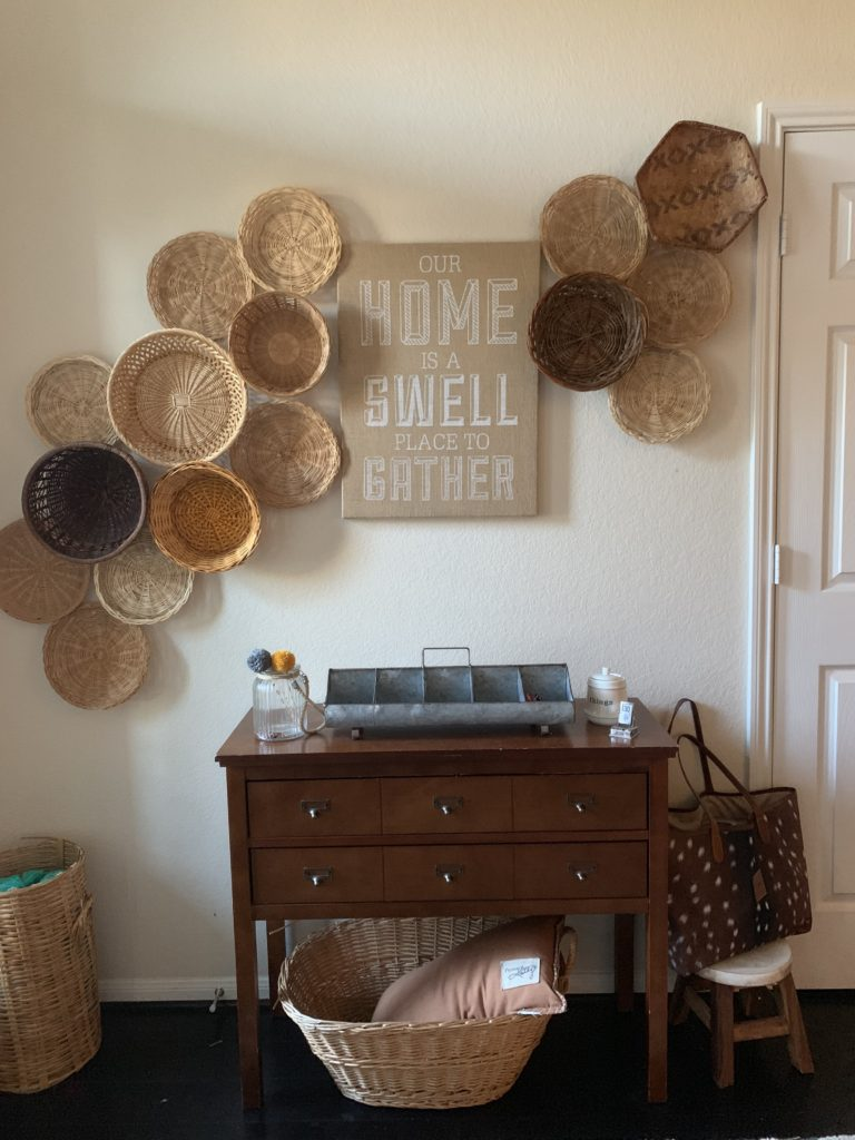 Gallery wall hanging tips - love the way she framed a piece of art with inexpensive baskets hung on the wall #baskets #bohodecor #art #diyart #eclecticdecor #gallerywall