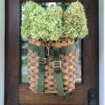 Adirondack Backpack History - love this gorgeous basket wreath filled with hydrangeas kellyelko.com #wreath #diywreath #adirondackbasket #basket #hydrangeas #falldecor