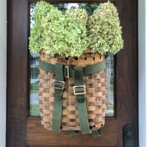 Adirondack Backpack History - love this gorgeous basket wreath filled with hydrangeas kellyelko.com #wreath #diywreath #adirondackbasket #basket #hydrangeas #falldecor