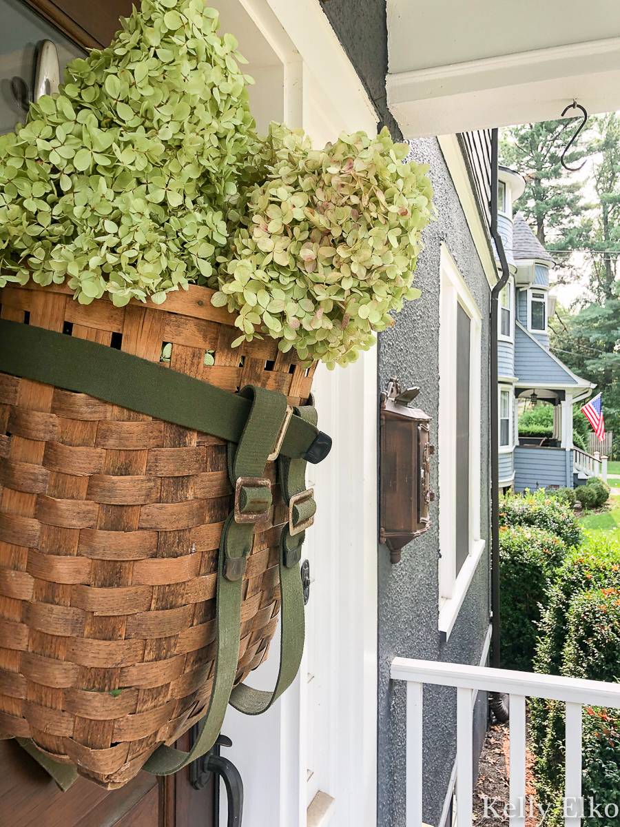 Love this basket wreath filled with hydrangeas kellyelko.com #basket #basketwreath #wreath #wreaths #fallwreath #summerwreath #curbappeal #diywreath #hydrangeas #limelight #vintagedecor #eclecticdecor #frontdoor