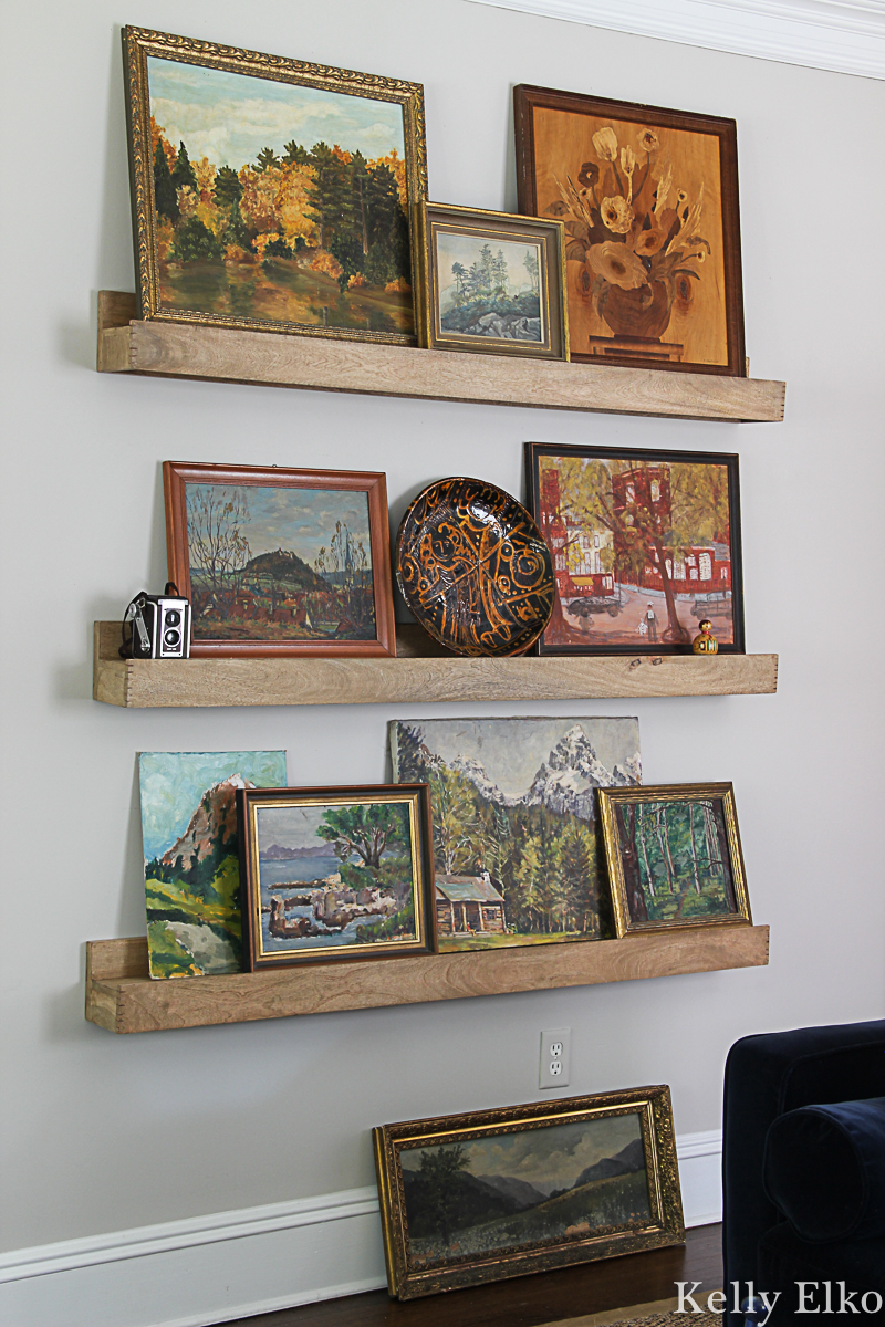 Love this unique vintage landscape painting gallery wall displayed on picture ledges kellyelko.com #vintagedecor #vintageart #vintagepaintings #vintagelandscape #gallerywall #falldecor #fallhometour #eclecticdecor #vintagemodern